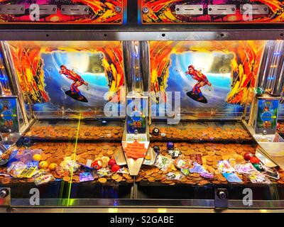 Penny falls machine at Barry Island leisure amusement arcade, as featured in the Gavin and Stacey television series. - Stock Photo