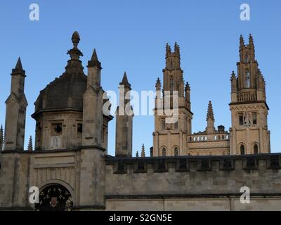 View of some of the 'dreaming spires' of Oxford, at All Souls College, Oxford University; an atmospheric view at sunset including the famous twin towers of Nicholas Hawksmoor. - Stock Photo