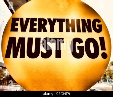Digitally altered 'Everything must go!' Poster in a shop window. Metaphor. Concept: All things must pass - Stock Photo