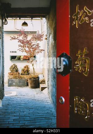 Traditional Chinese door in Beijing Hutong, China. - Stock Photo