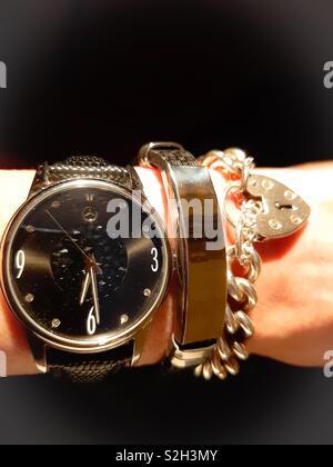 Beautiful trio. Mercedes watch with a Dubai bracelet and a genuine Silver charm bracelet. - Stock Photo