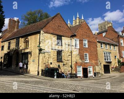 The 'Norman House' on Steep Hill, Lincoln, a Romanesque medieval first floor hall of the 13th Century and one of the five medieval 'Jews Houses' in England, which had Jewish residents. - Stock Photo