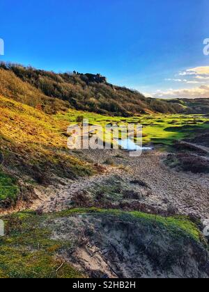 Pennard castle overlooking Pennard Pill, Three cliffs bay, Gower, Swansea, Wales, February. - Stock Photo