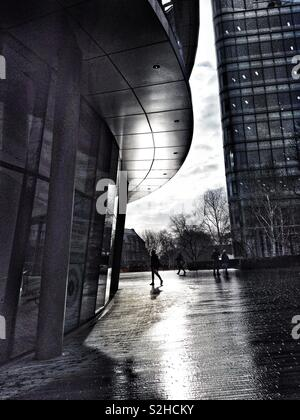 The reflections of winter sun outside City Hall in London, England, UK - Stock Photo