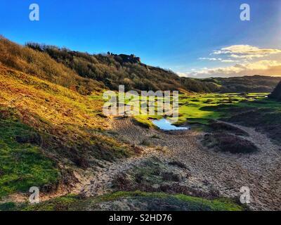 Pennard Castle overlooking Pennard Pill, Gower, Swansea, Wales, February. - Stock Photo