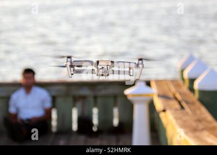 A drone pilot flying his DJI Mavic Pro. - Stock Photo