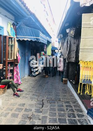 Eager Shoppers In Chefchaouen  Location: Chefchaouen, Morocco | Photography Artist: Winter Monroe, 2018 - Stock Photo