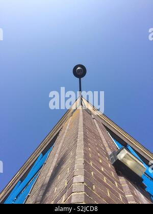 Public camera surveillance on building - Stock Photo