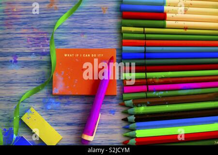 Painting set. Wooden grunge floor. Top view of crafting table arrangement. Acrylic paint splattered. - Stock Photo