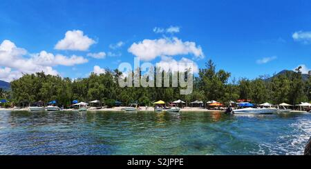 View of the beachfront in the island Île aux Benitiers in Mauritius on summer season - Stock Photo