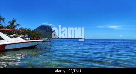 Blue sky and calm sea and view of the mountain Le Morne Brabant in Mauritius - Stock Photo