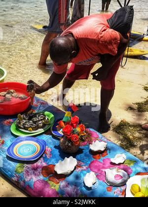 Man selling fresh oysters on the beach