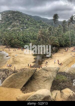 Beach, jungle, mountain view in Tayrona National Park in Santa Marta, Colombia. - Stock Photo