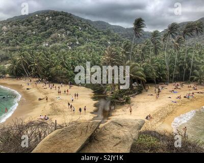 A mountain, jungle and beach view in Tayrona National Park in Santa Marta, Colombia. - Stock Photo