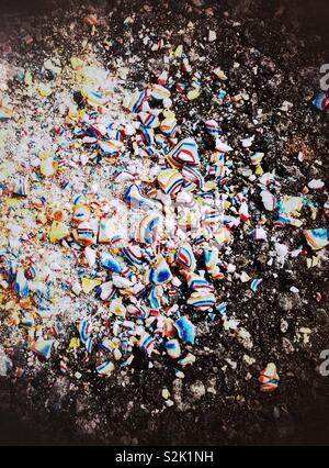 Crushed candy in rainbow colors on pavement - Stock Photo