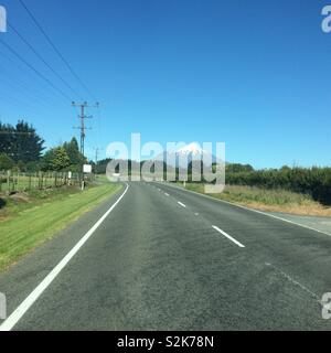 View of Mount Taranaki / Mount Egmont driving along state highway 43, New Zealand - Stock Photo