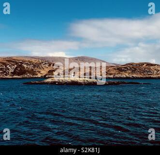 Lighthouse off the coast of scalpay - Stock Photo