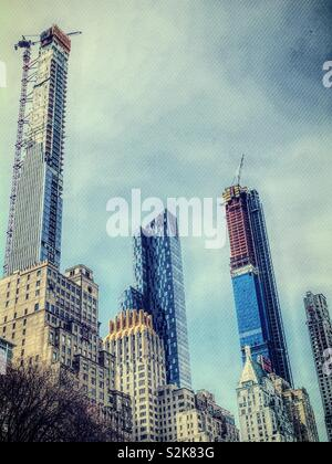 Super tall buildings along Central Park South in midtown Manhattan, NYC, USA - Stock Photo