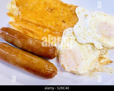 Fried egg, sausage and melted cheese breakfast - Stock Photo