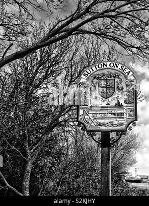 Roadside signpost for Sutton on Sea village in Lincolnshire, England, UK. - Stock Photo