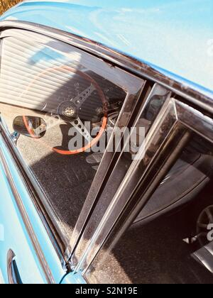 Steering wheel of an Oldtimer in Sky Blue - Stock Photo