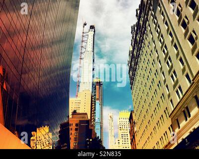 Super tall condominium buildings on W. 57th St. in Midtown Manhattan under construction, NYC, USA - Stock Photo
