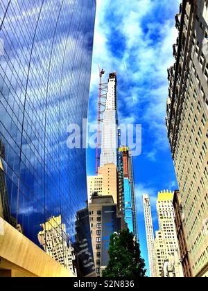 Super tall condominium buildings under construction on W. 57th St. in Midtown Manhattan NYC, USA - Stock Photo