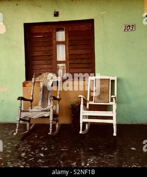 Two old rocking chairs on the porch of a house in Cuba - Stock Photo