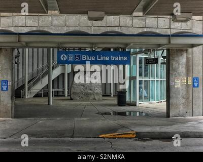 Chicago's cta Blue Line train station and overhead sign. - Stock Photo