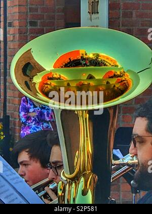 Reflection of buildings in the horn of the big brass tuba - Stock Photo