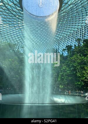 Jewel waterfall at Changi airport in Singapore dazzling in the sunlight. - Stock Photo