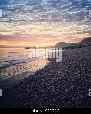 Sidmouth Beach Devon Sunset over the sea - Stock Photo