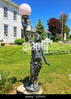 8th June 2019, Egg Harbor, WI, USA, Door County's Egg Harbor celebrates its 55th anniversary, pictured is bronze lamppost in front of the historic Cupola House - Stock Photo