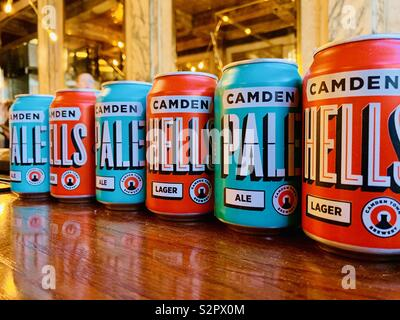 London,UK - 15th June 2019 - Cans of Camden Brewery lager and pale ale lined up in a burger restaurant on The Strand. - Stock Photo