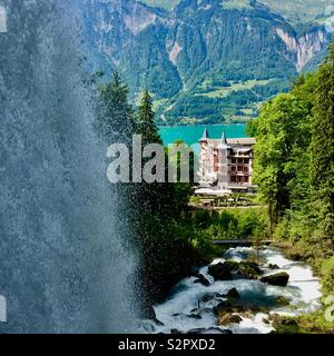 Giessbach waterfall and historic hotel, Lake Brienz, Bernese Oberland, Switzerland. - Stock Photo