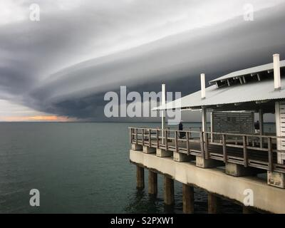 Storm cell approaching Woody Point Jetty, Redcliffe, Queensland. Taken June 16, 2019. - Stock Photo