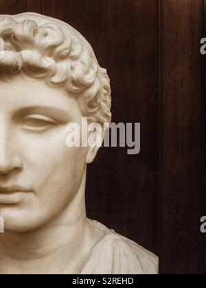 Head of classical statue of a young man. - Stock Photo