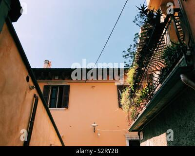 View of wall in Italy with balcony - Stock Photo