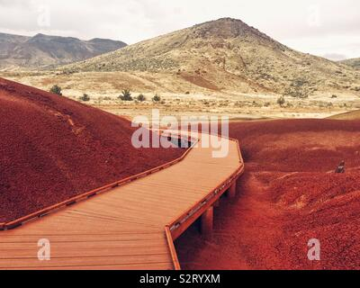 Surreal martian landscape in Painted Hills natural area in Oregon - Stock Photo