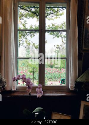 window in Claude Monet house in Giverny, France - Stock Photo