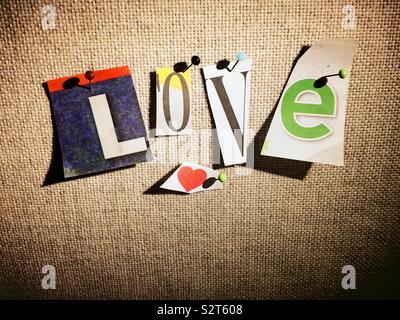 The word love spelled out in Ransom note style on a bulletin board, USA - Stock Photo