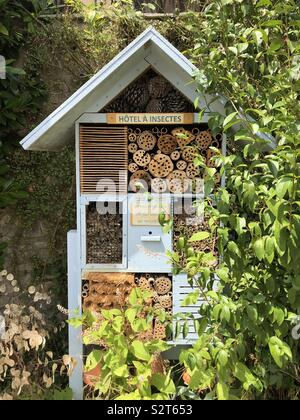 Insect hotel seen in a French village - Stock Photo