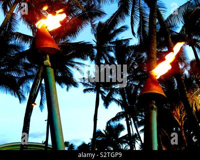 Hawaiian Tiki Torches - Stock Photo