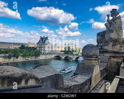 A view of The Louvre Museum and the Seine River from top of the Musee D'Orsay in Paris France. - Stock Photo