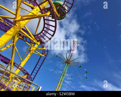 Wild Mouse roller coaster and Star Flyer chair ride at Barry Island Pleasure Park, South Wales. - Stock Photo