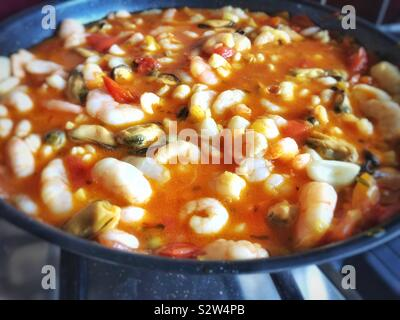 Seafood in saffron, garlic vermouth and tomato sauce.