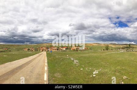 Road, village and window farm. Villacadima, Spain. - Stock Photo