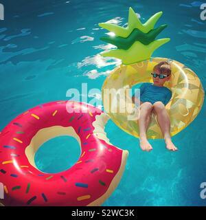 Boy on a Pineapple Float - Stock Photo
