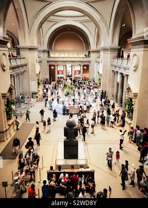 The great Hall at the Metropolitan Museum of Art is filled with visitors on a daily basis, NYC, USA - Stock Photo