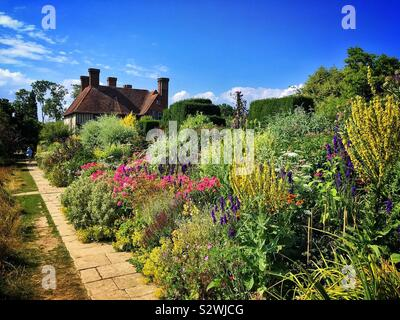 Herbaceous flower border in summer at Great Dixter in East Sussex, probably the best English cottage style gardens. - Stock Photo